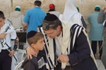 Father and son at the Wailing Wall.