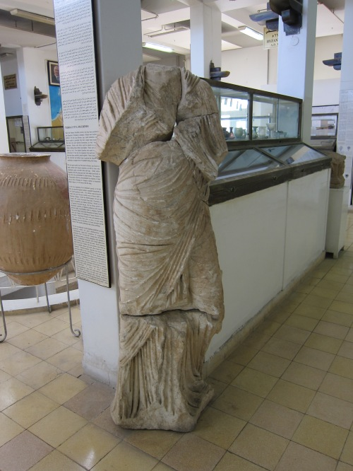 Headless statue at Jordan Archaeological Museum.