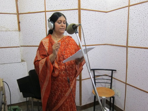 Vinita Shaw recording her radio program in the studio.