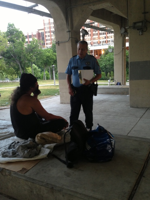 Officer Giraldo assessing needs of a homeless man.