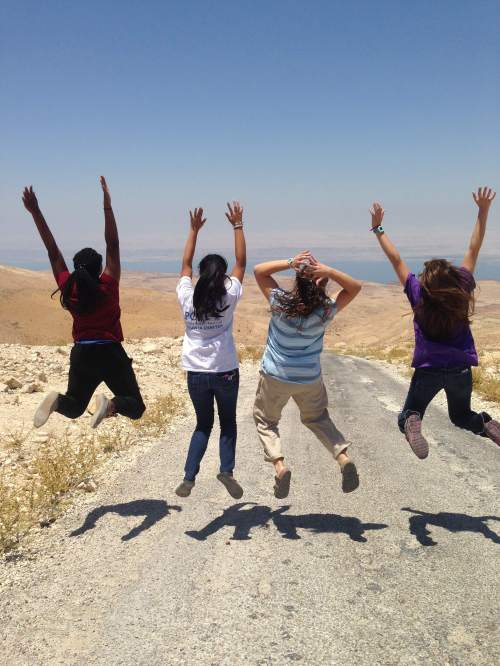 Students kicking up the dust of history near the Dead Sea.