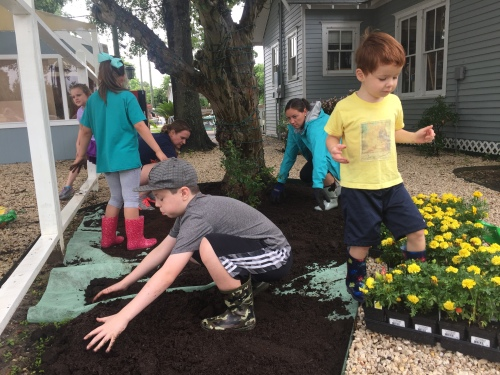 Manna House Kids Planting Flowers